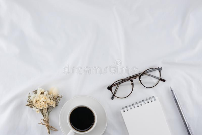 A cup of coffee, notebook, eyeglasses, pen stock images