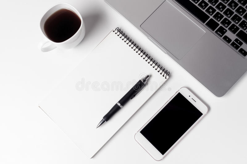 Cup With Coffee, Notebook With Pen And Smartphone Near Laptop. At Working Space royalty free stock photography