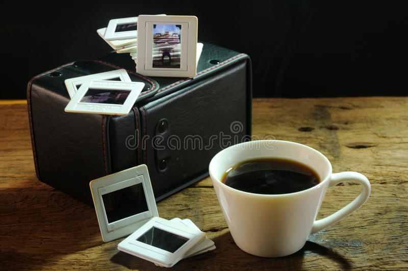 Cup of coffee and old film slides of art and culture memories royalty free stock photos