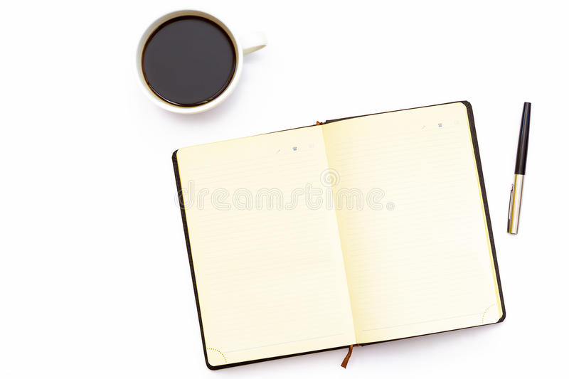 Cup of coffee, open the diary and pen on a white background. Minimal business concept of working place in the office. Flat lay. Top view royalty free stock photo