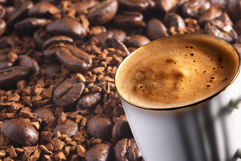 Cup of coffee over coffee background stock photos