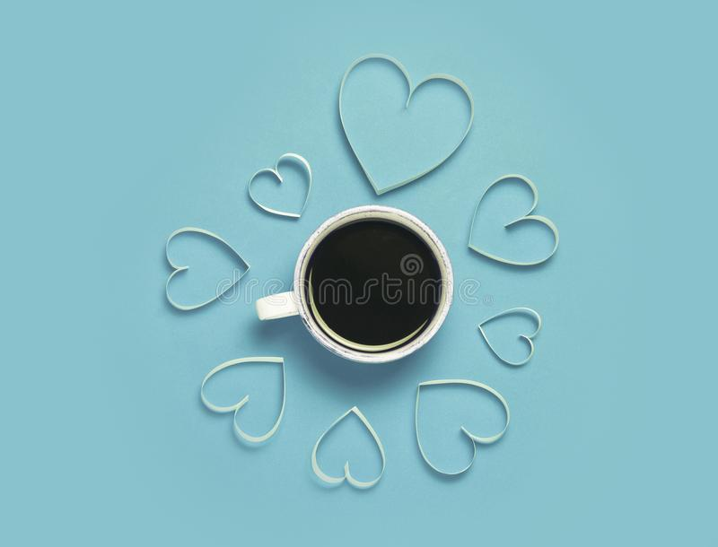 Cup of coffee and paper hearts on red background. St.Valentine`s day greeting concept. Lovely and minimalistic picture. Top view, stock image