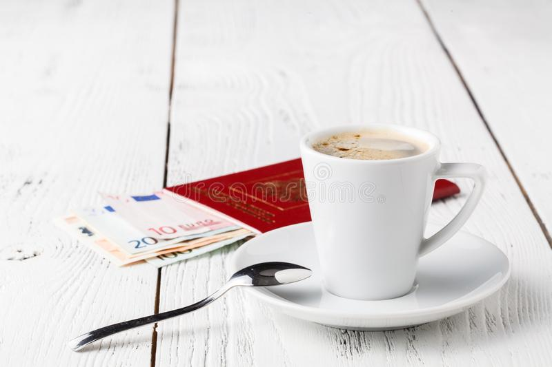 Cup of coffee, passports and no name boarding passes. Traveling concept stock photos