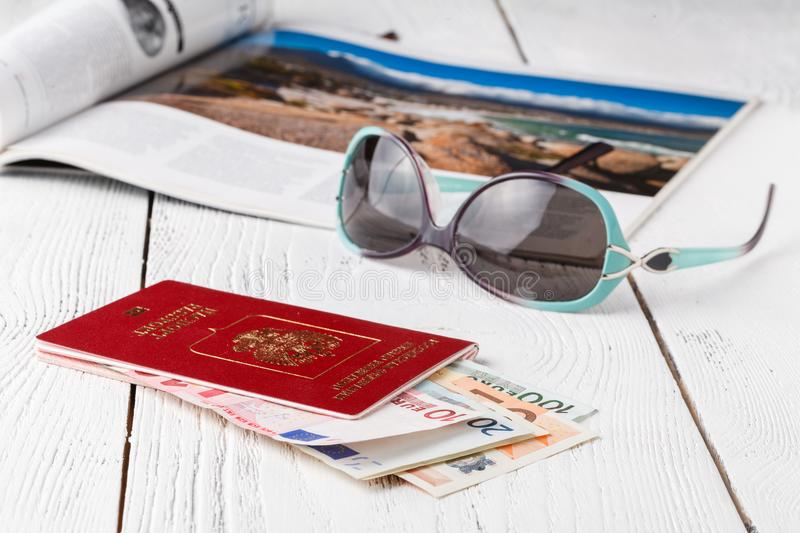 Cup of coffee, passports and no name boarding passes. Traveling concept stock image
