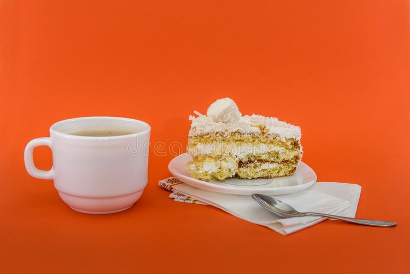 Cup of coffee with piece of tasty cake.  stock photography