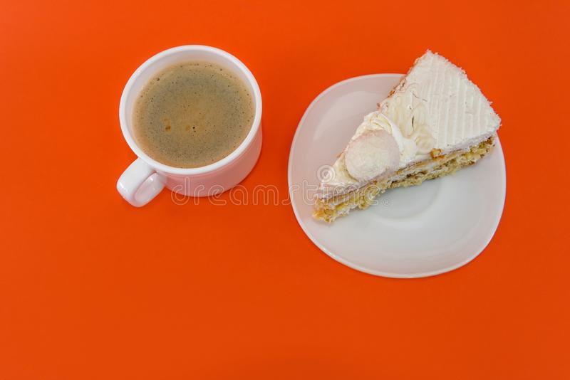 Cup of coffee with piece of tasty cake.  royalty free stock image