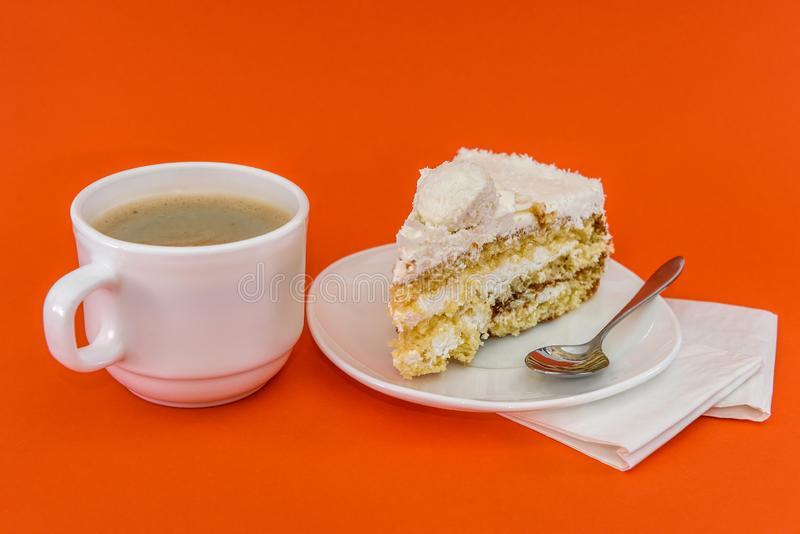 Cup of coffee with piece of tasty cake.  royalty free stock photography