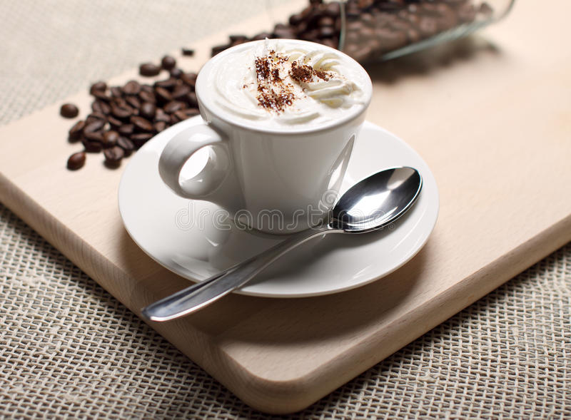 Download Cup Of Coffee With A Skin And Coffee Grains Stock Image - Image: 23701827