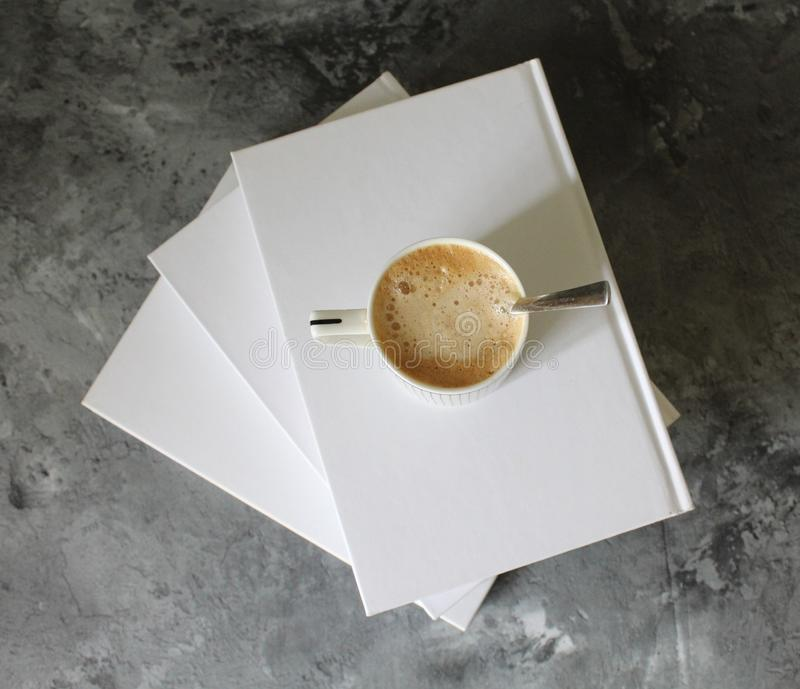 A cup of coffee and some books royalty free stock images