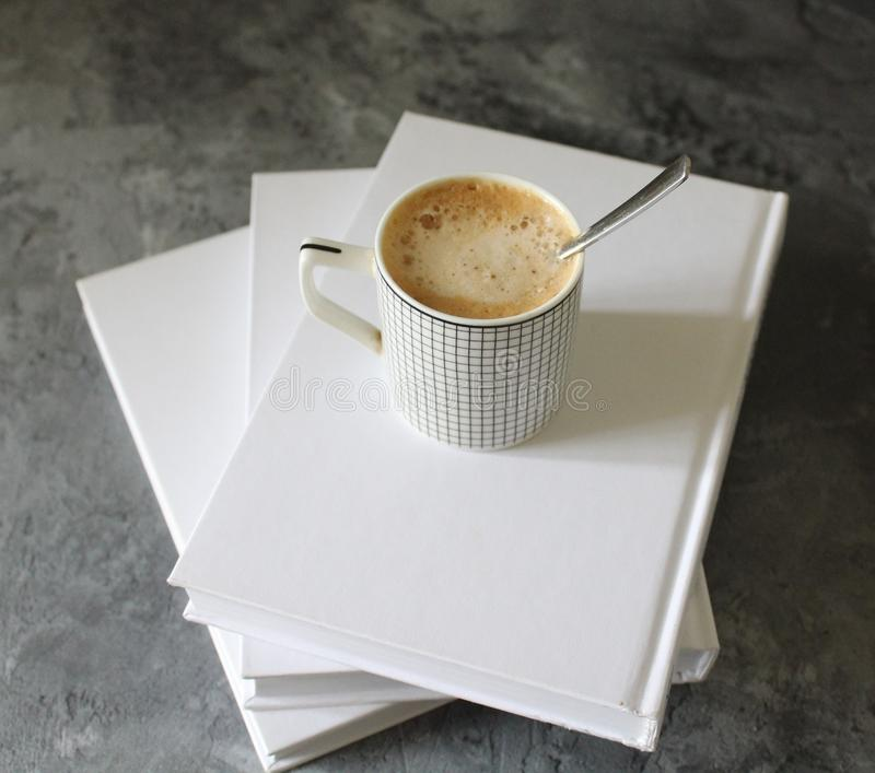 A cup of coffee and some books royalty free stock photos