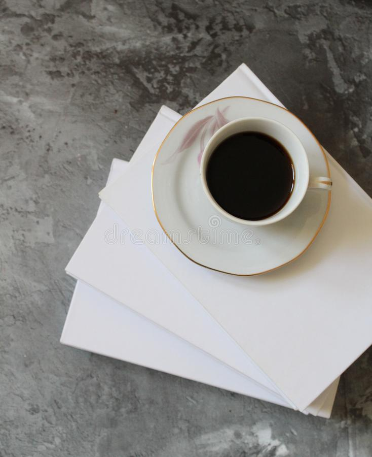 Coffee and books on marble background royalty free stock photography