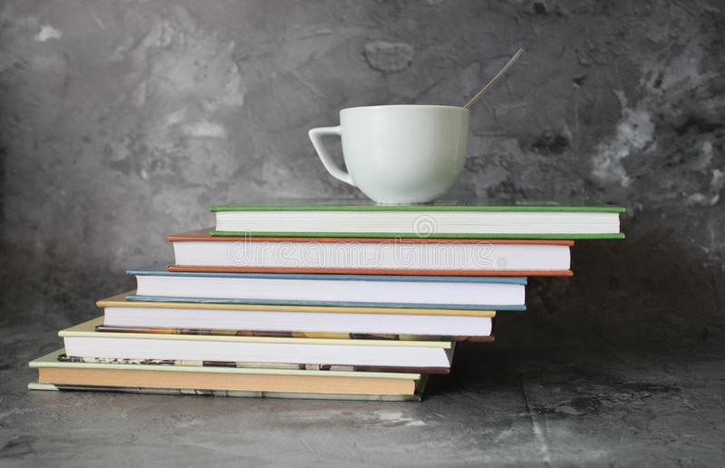 Coffee and books on marble background royalty free stock image