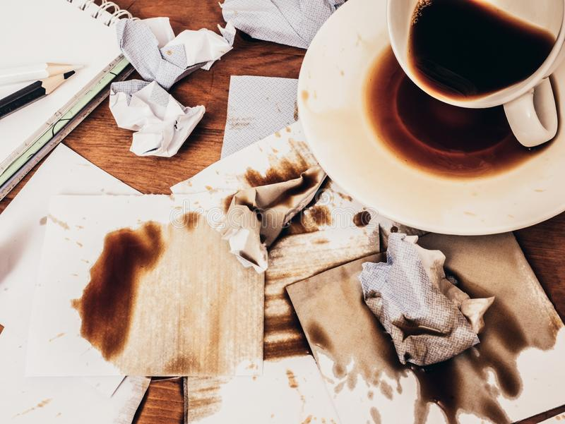 Cup of coffee spilt on wood table, top view. royalty free stock images