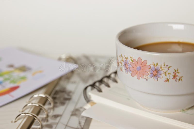Download A Cup Of Coffee On Spiral Notebook Stock Illustration - Image: 22861054