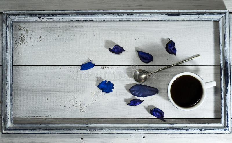 Cup of coffee and spoon in the old frame royalty free stock photo