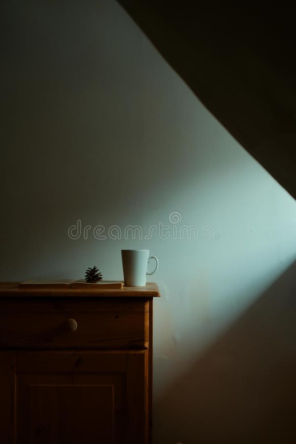 The cup is on the nightstand royalty free stock photography