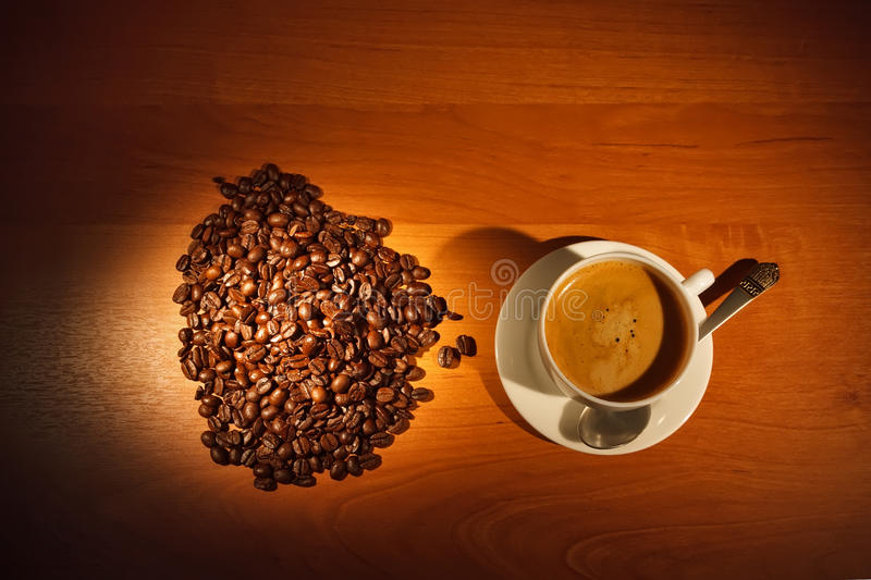 Cup with coffee and steam. Coffee cup with steam and coffee beans royalty free stock images
