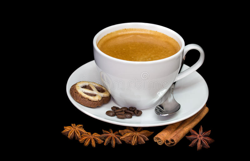 Cup of coffee. With steam, coffee beans, chocolate pieces, cinnamon sticks and anise on black background royalty free stock photos