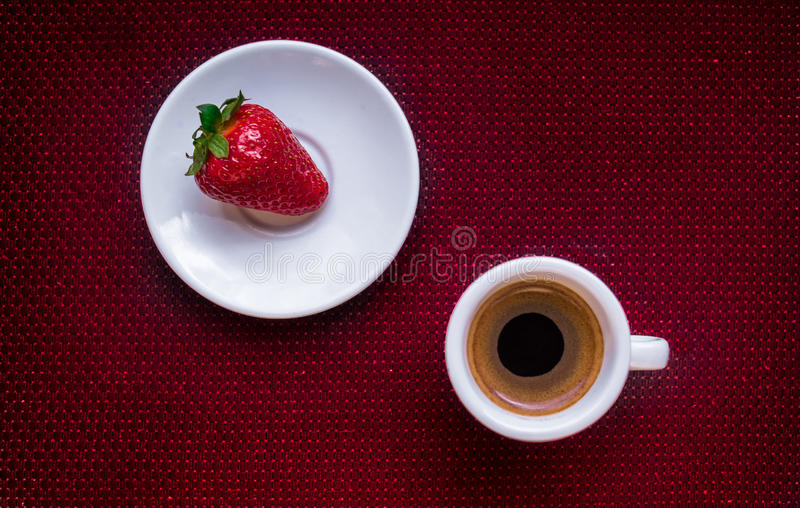 Cup of coffee and strawberry royalty free stock photos