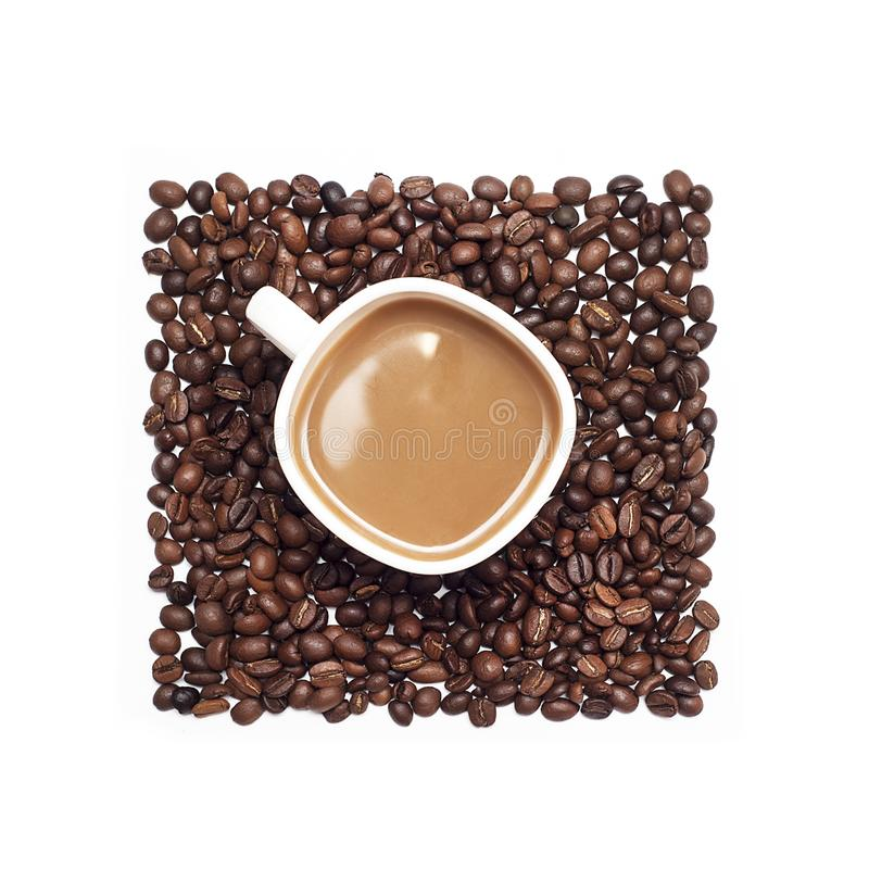 Cup of coffee surrounded by coffee beans stock photos