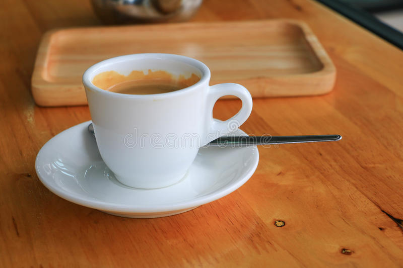 Cup of coffee on the table royalty free stock photos