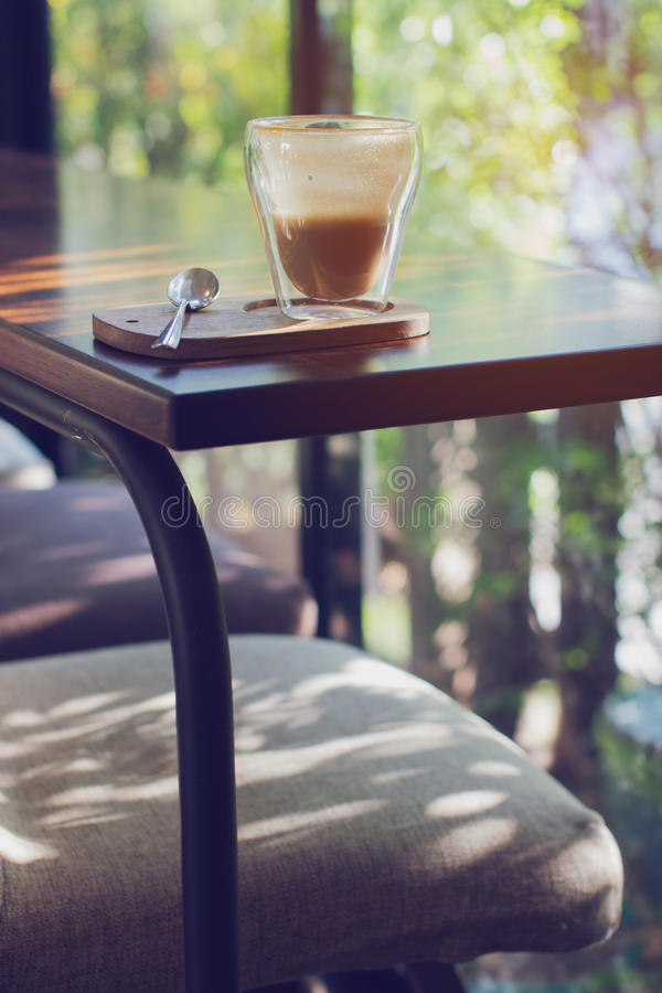 Cup of coffee on table in coffee shop. Hot cappuccino royalty free stock photos