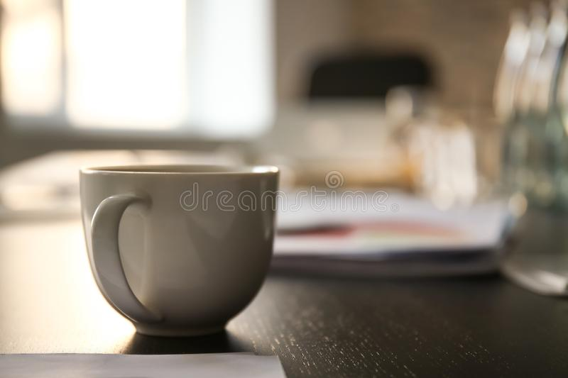 Cup of coffee on table prepared for business meeting in conference hall stock photography