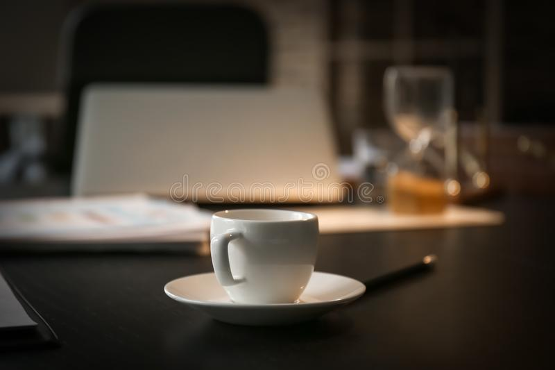 Cup of coffee on table prepared for business meeting in conference hall stock photo