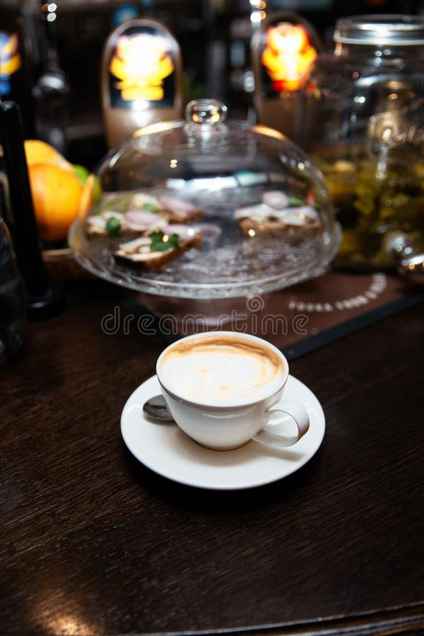 Cup of coffee on table in coffee shop cafe royalty free stock photos