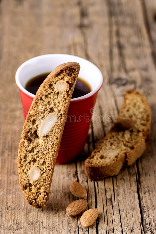 Cup of Coffee and Tasty Traditional Italian Sweets Biscotti or Cantucci on Wooden Background Italian Biscotti for Coffee or Wine. Italian Snack Vertical stock image