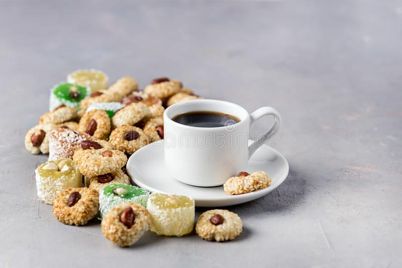 Cup of Coffee and Tasty Turkish Delight Oriental Dessert Lokum and Oriental Cookies Copy Space stock photos