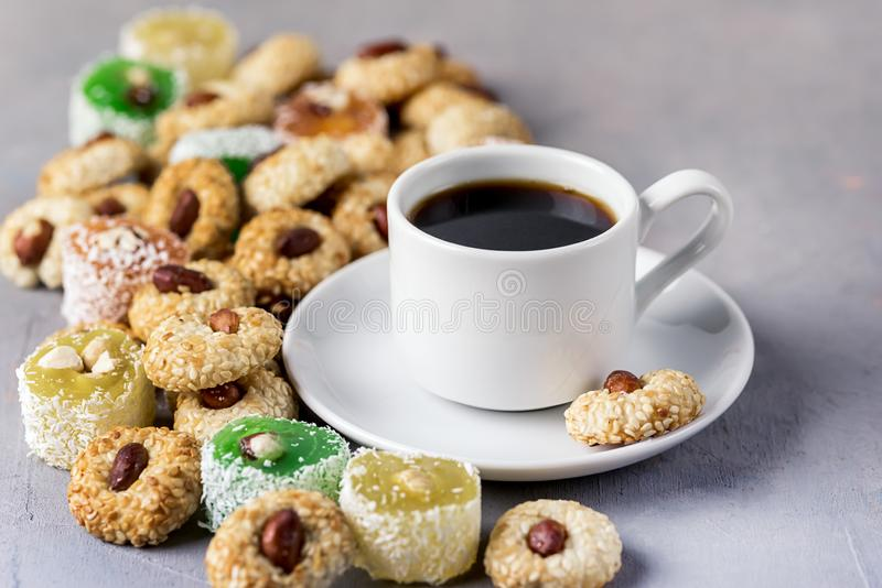 Cup of Coffee and Tasty Turkish Delight Oriental Dessert Lokum and Oriental Cookies Close Up royalty free stock photos