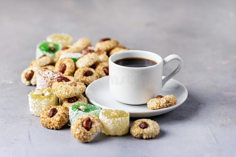 Cup of Coffee and Tasty Turkish Delight Oriental Dessert Lokum and Oriental Cookies stock photography