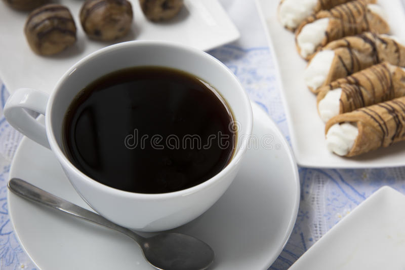 Cup of Coffee and Treats stock photography