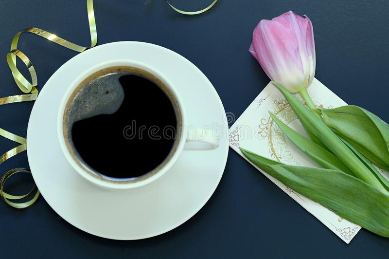 Cup of coffee and Tulip stock photography