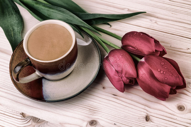 Cup of coffee with tulips Vintage still life royalty free stock photo