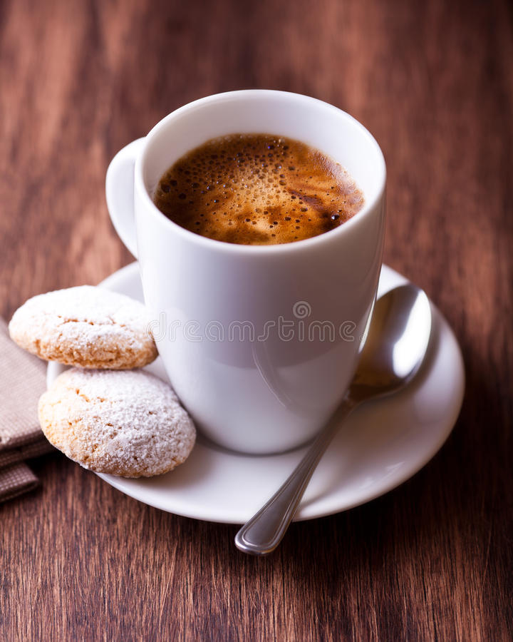 Cup of coffee and two biscotti stock images
