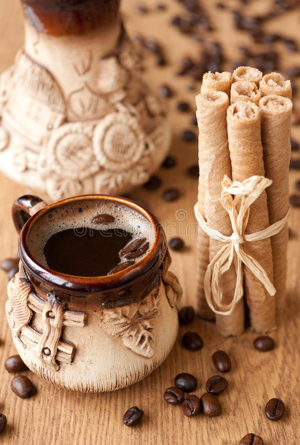 Cup of coffee and wafer rolls stock photo