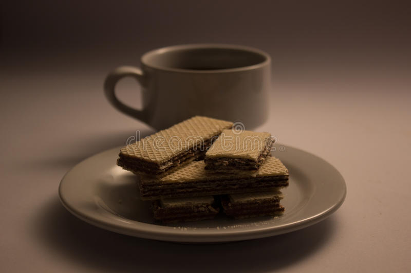 A cup coffee and wafer royalty free stock photos