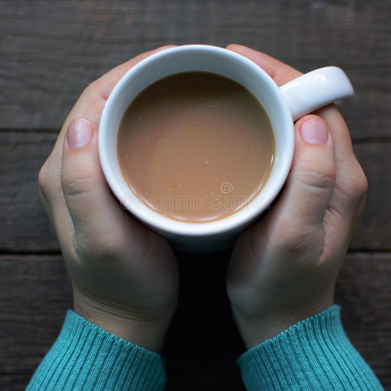 Cup of coffee in hands. Always warm & tasty stock photos
