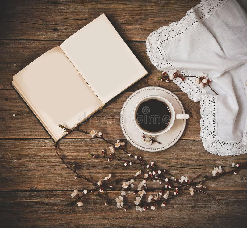 Cup coffee white saucer book wooden background stock photos