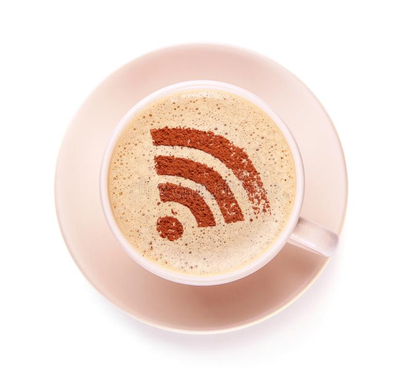Cup of coffee with WiFi sign on the foam. Free access point to the Internet WiFi stock photo