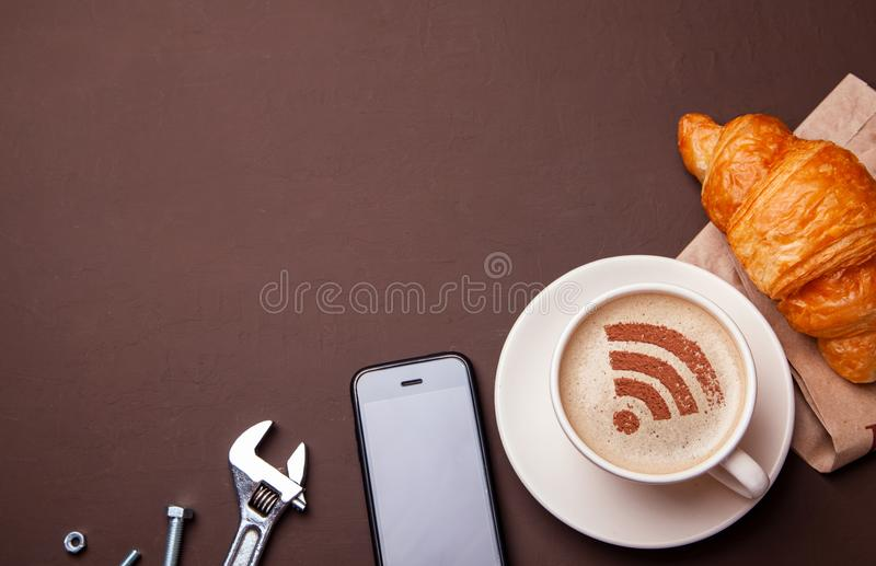 Cup of coffee with WiFi sign on the foam stock image