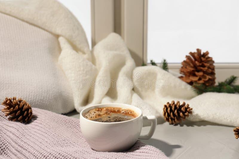 Cup of coffee on windowsill indoors. Winter drink. Cup of coffee on windowsill indoors, space for text. Winter drink stock photos