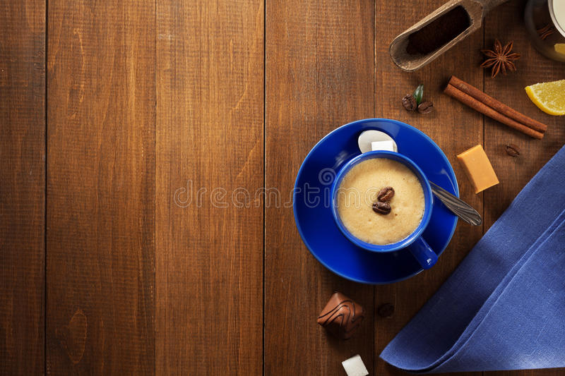Cup of coffee on wood royalty free stock photography