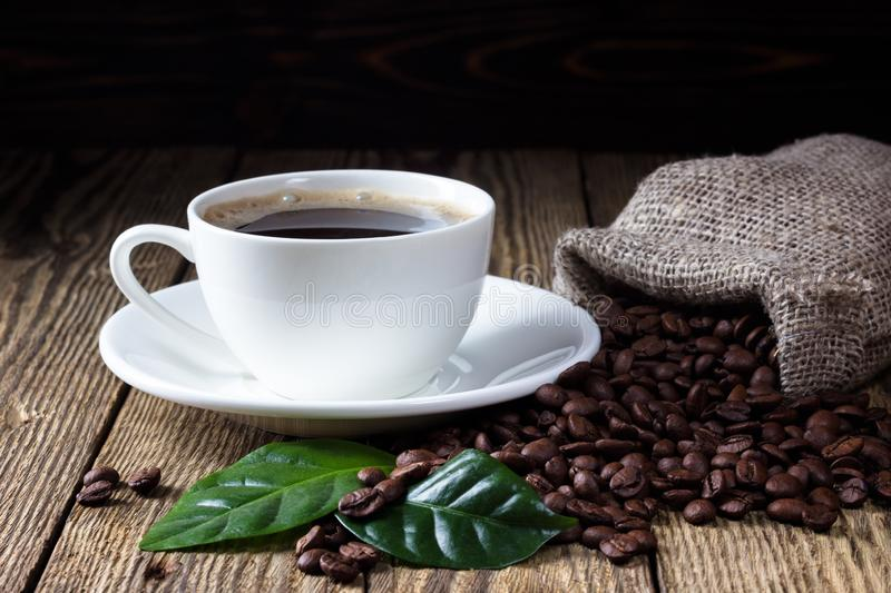 Cup of coffee on wooden rustic table royalty free stock photos