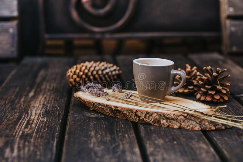 A cup of coffee on a wooden stand royalty free stock photography