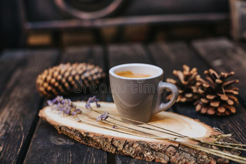 A cup of coffee on a wooden stand stock images