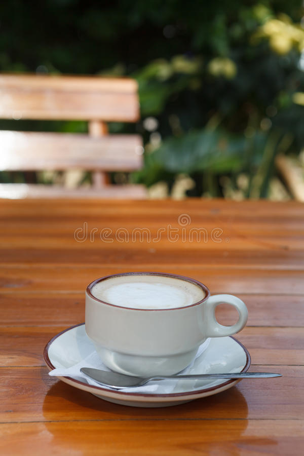 A Cup of coffee on wooden table.  royalty free stock photography