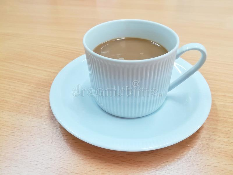 A cup of coffee on wooden table in cafe or meeting room. Picture with copy space stock image